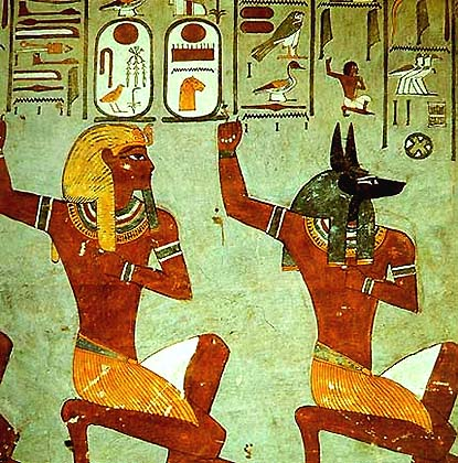 The god Anubis and pharaoh perform a ritual. Cultic initiation scene. Fresco in Egyptian king's tomb